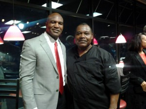 Former Heavyweight Boxing Champion Evander Holyfield with Ms. Piggies' co-founder